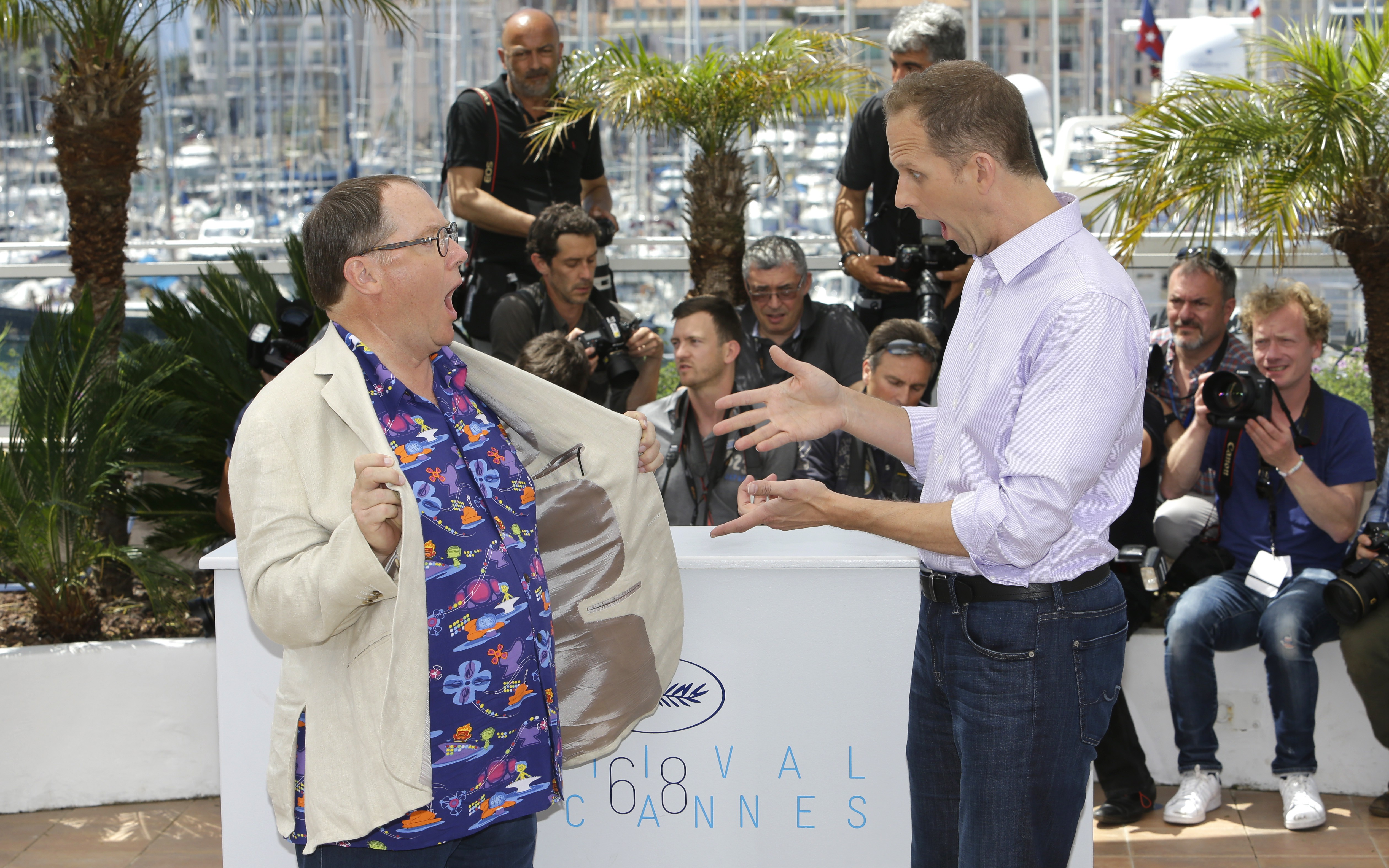 Chief creative officer of Pixar John Lasseter and director Pete Docter pose during a photo call for the film Inside Out, at the 68th international film festival, Cannes, southern France, Monday, May 18, 2015. (AP Photo/Lionel Cironneau)