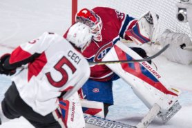 Montreal Canadiens goalie Mike Condon gloves a shot off Ottawa Senators' Cody Ceci for the save during first period NHL hockey action Tuesday, November 3, 2015 in Montreal. THE CANADIAN PRESS/Paul Chiasson