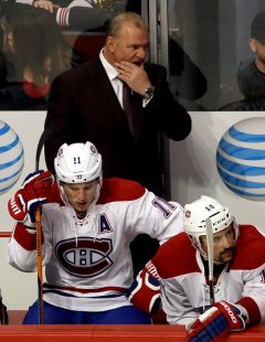 Montreal Canadiens head coach Michel Therrien, top, right wing Brendan Gallagher (11) and center Tomas Plekanec (14) react as they watch players during the third period of an NHL hockey game against the Chicago Blackhawks Sunday, Jan. 17, 2016, in Chicago. The Blackhawks won 5-2. (AP Photo/Nam Y. Huh)