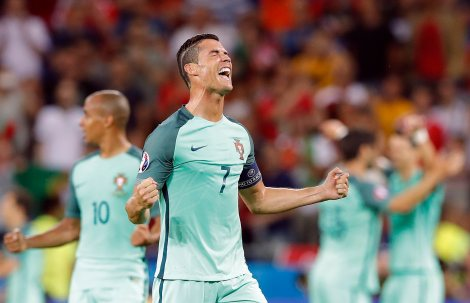 Portugal's Cristiano Ronaldo celebrates at the end of the Euro 2016 semifinal soccer match between Portugal and Wales, at the Grand Stade in Decines-Charpieu, near Lyon, France, Wednesday, July 6, 2016. Portugal won the match 2-0. (AP Photo/Laurent Cipriani)