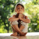 girl on meditation in the morning park