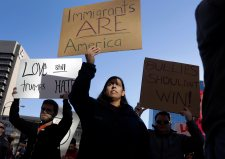 Protesters hold signs as they march in opposition to the election of President-elect Donald Trump on Sunday, Nov. 13, 2016, in St. Louis. Demonstrations also took place internationally. A group of Mexicans at statue representing independence in Mexico City expressed their concerns about a possible wave of deportations. (AP Photo/Jeff Roberson)