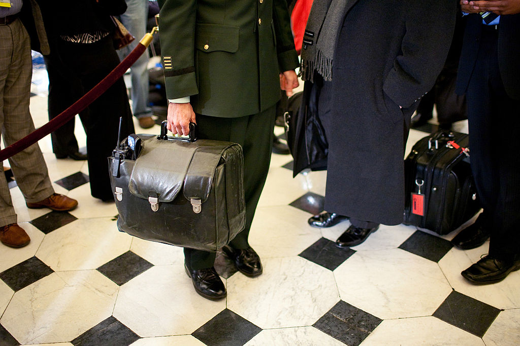 WASHINGTON - FEBRUARY 24: A military aide carries the nuclear football, with the nation's nuclear launch codes, through Statuary Hall as President Barack Obama arrives at the U.S. Capitol for his address to a joint session of Congress on February 24, 2009 in Washington, DC. U.S. President Barack Obama will address a joint session of the Congress at 9:01pm tonight where he plans to address the topics of the struggling U.S. economy, the budget deficit, and health care. (Photo by Brendan Hoffman/Getty Images)