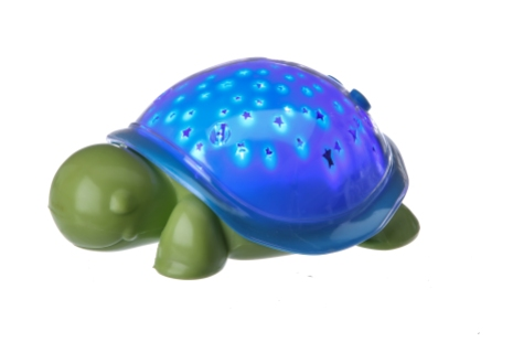 The SuperMax the Turtle nightlight, inspired by Max Wilford, an 8-year-old boy with brain cancer, in New York, Sept. 16, 2015. Like its larger predecessor, Cloud b's Twilight Turtle, SuperMax projects a starry night sky on the walls and ceiling of a room, helping to ease fear of the dark. (Tony Cenicola/The New York Times)