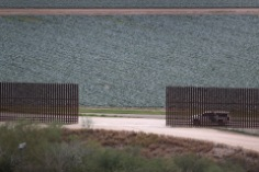 MCALLEN, TX - JANUARY 05: A U.S. Border Patrol vehicle sits waiting for illegal immigrants at a fence opening near the U.S.-Mexico border on January 5, 2017 near McAllen, Texas. The number of incoming immigrants has surged ahead of the upcoming Presidential inauguration of Donald Trump, who has pledged to build a wall along the U.S.-Mexico border. (Photo by John Moore/Getty Images)