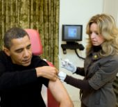 WASHINGTON - DECEMBER 20: In this handout provided by the White House, A White House nurse prepares to administer the H1N1 vaccine to President Barack Obama at the White House on December 20, 2009 in Washington, DC. The Senate passed the first of three crucial procedural votes on health care by a 60 to 40 margin the following day on December 21, 2009 in Washington, DC. (Photo by Pete Souza/White House via Getty Images)