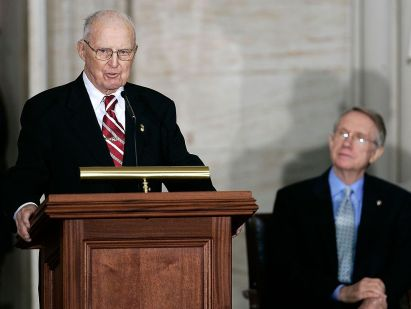 WASHINGTON - JULY 17:  Agricultural scientist Norman E. Borlaug speaks as U.S. Senate Majority Leader Sen. Harry Reid (D-NV) looks on during a Congressional Gold Medal presentation ceremony July 17, 2007 on Capitol Hill in Washington, DC. Borlaug, a 1970 Nobel Peace Prize recipient, was awarded the medal for his work on developing a strand of disease-resistant wheat, in turn increasing food supply throughout the world.  (Photo by Alex Wong/Getty Images)