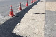 Boulevard Industriel : de l'asphalte comme solution temporaire pour les trottoirs dégradés