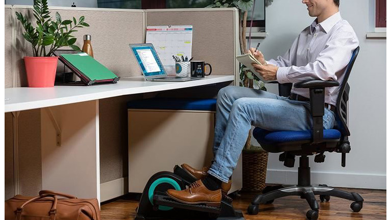 cubii jr elliptical sitting desk living room