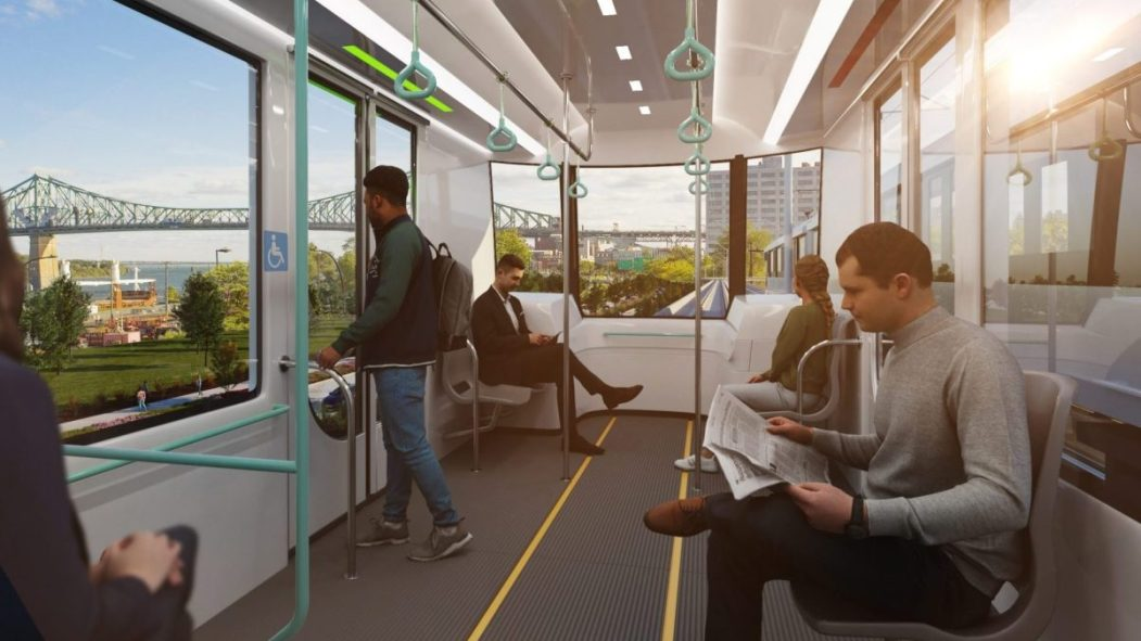 Maquette montrant des passagers assis dans un train du futur REM de l'Est, qui sera construit selon un tracé aérien.